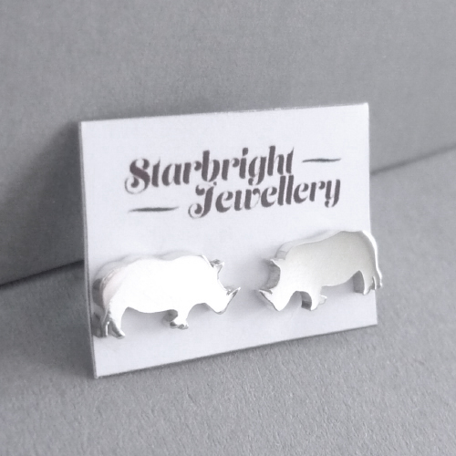 Sweet little sterling silver rhino stud earrings.