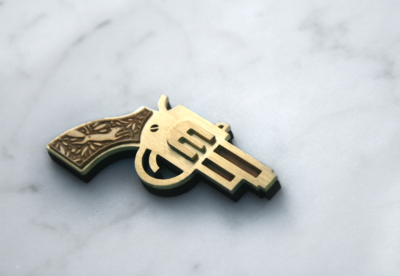 Brass and wood brooch with wooden veneer handle