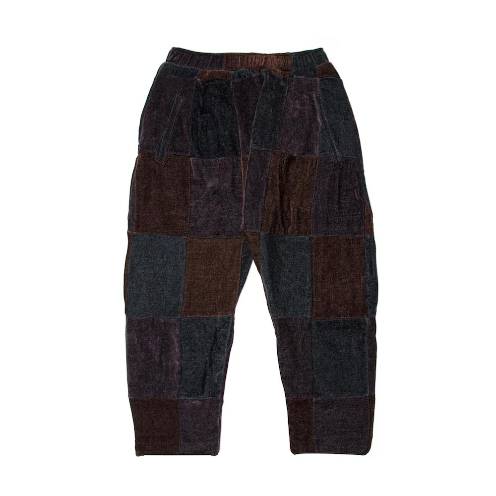 A patchwork cropped trouser, finished with deep internal side pockets and elasticated drawstring. Cut from a luscious chenille throw milled by South African heirloom textile mill, Mungo. 