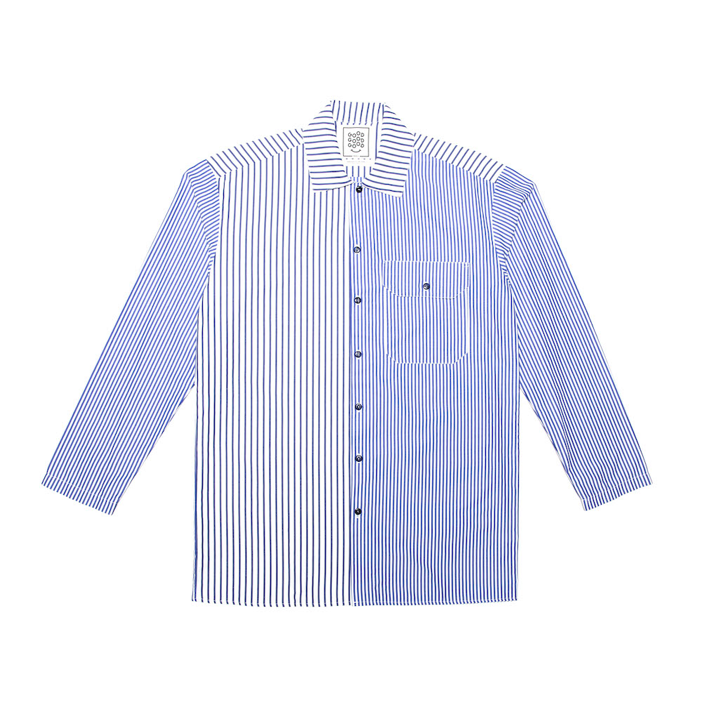 A classic box-shaped shirt featuring irregular striped panels and a utility pocket with pen insert. Cut from a lightweight 100% cotton. Finished with a straight hem and hemmed cuffs.