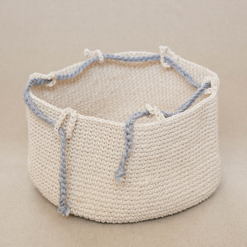 Lapoplap's original hand crocheted baskets, with an added drawstring. Beautifully display bread rolls, toast, fresh fruit, a vase of flowers or pot plant, toiletries, or smaller items in this unique, stylish basket. Use as a centrepiece in your table decor or to organise and brighten that special corner. Keep bread warm on your table and easily pop them in the microwave bread-and-all to heat as necessary.