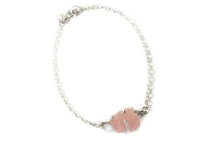 Semi-precious un-cut gemstone set in sterling silver claws with silver bracelet chain.