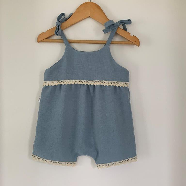 We love this simple yet beautiful romper. The slightly loose fit is perfect for those hot summer days.  Features:   Linen or cotton light weight fabrics (please do NOT tumble dry - will cause shrinkage) Bow tie shoulder straps