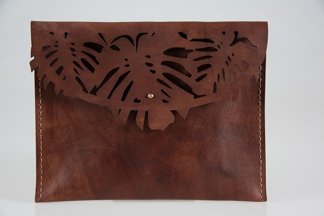 The Paradise Clutch is inspired by the gorgeous Delicious Monster plant on our desk. It is laser cut and hand stitched, blending the new and the traditional.  