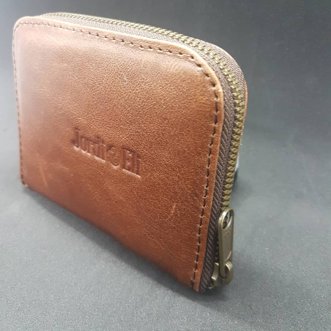 The small zip around is the perfect size for those that don't like big handbags or for the man that wants to make sure everything is kept safe.