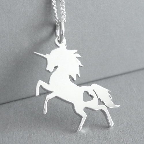 This is a magical prancing Unicorn Pendant - cut by hand, and measuring approx. 20x24mm in size.