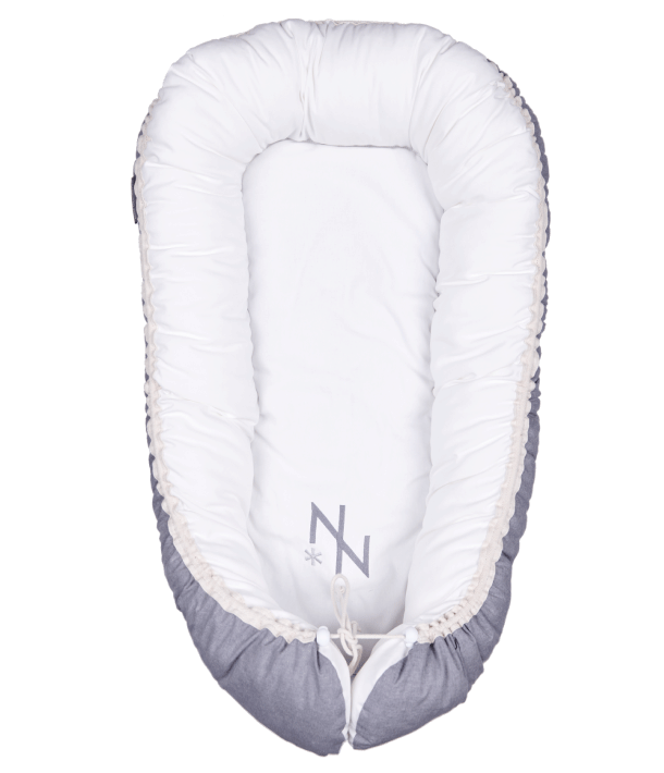 The lightweight, easy-to-carry cocoon is lined with 100% cotton and not only keeps your baby safe and snug, but also offers a great solution for traveling, co-sleeping and nappy changing via an adjustable bottom flap, whether you're at home or on the go.