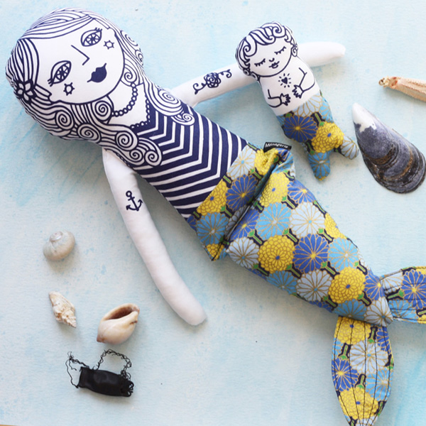 Mermaid Pearl and her merbaby are cloth dolls. She is an original design and inspired by decorative vintage Scandinavian illustration, and kids play. She is made from a soft white 100% cotton, and stuffed with the best quality poly toy stuffing. The designs are screen printed on the fabric in navy water based eco-friendly ink. Her tail is made from 100 cotton fabric in a limited variety of designs. 