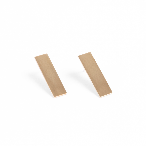These bar studs are the beautiful basics of the Look Up collection. They are simple and elegant and based on the building blocks of our city, the bricks that build the walls, that form the structures that make up our neighbourhoods and the places where we live and work. They're easy-to-wear, match-with-everything kind of earrings! Available in rose gold plated copper with plated sterling silver studs or yellow gold plated brass with sterling silver studs. The studs are 2.5cm long x 0.7cm wide and come with a sterling silver butterfly.